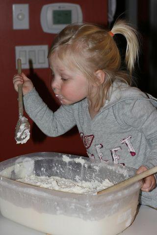 Ellie-making-crafts-from-glue-paper-popsicle-sticks